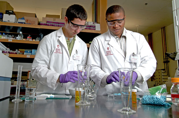 Two pharmacy students in a lab