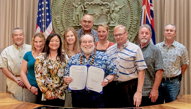 Group of people with Hawaii Governor Neil Abercrombie