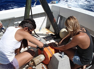 Two students working on a boat