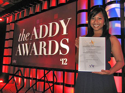 Jillian Roque holding an award