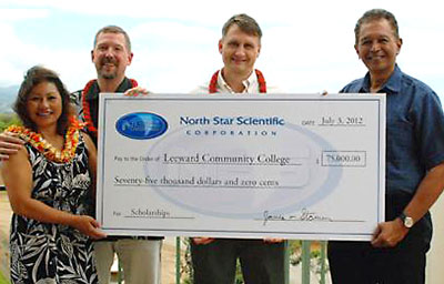 A group holding a donation check