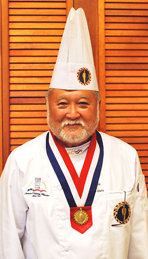Head shot of Allan Okuda in chef uniform