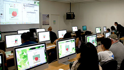 People in classroom of computers