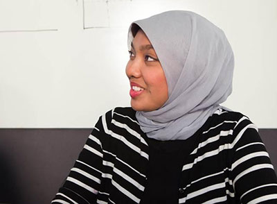 A University of Hawaiʻi at Mānoa Shidler College of Business MBA student wearing a hijab (headscarf).