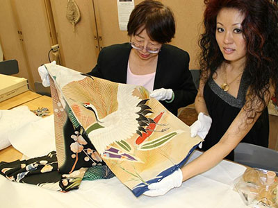 Associate Professor Shu Hwa Lin and a Fashion Design and Merchandising student examine a kimono.