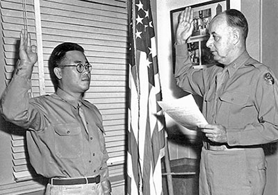 Arthur Komori is sworn in as a member of the Corps of Intelligence Police of the U.S. Army on March 13, 1941 at Fort Shafter in Honolulu.