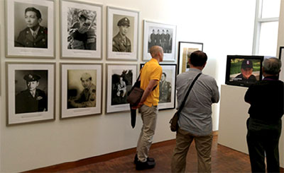 viewers in gallery exhibit