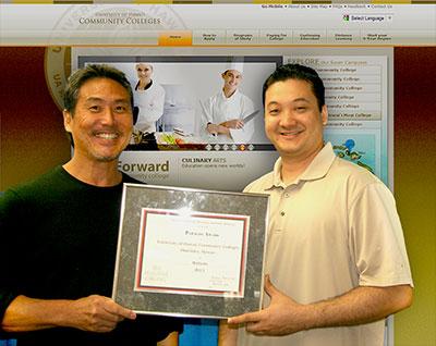 two men holding an award