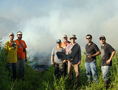 group of people standing by lava