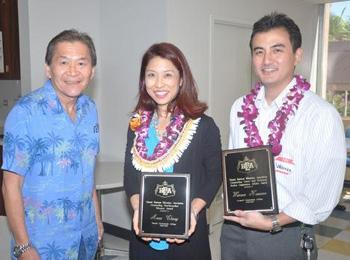 three people holding award