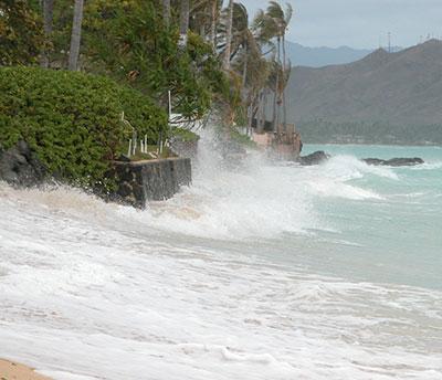Hawaii beach shoreline water rushing up the beach