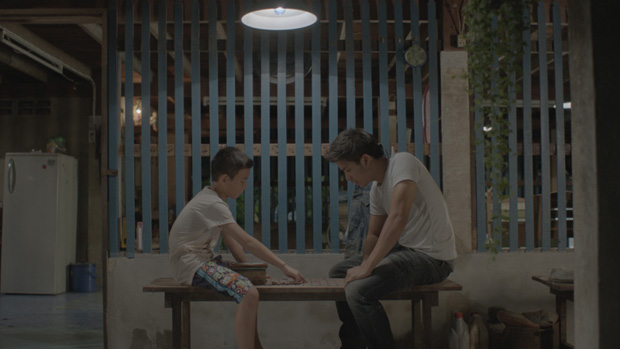 two boys playing checkers