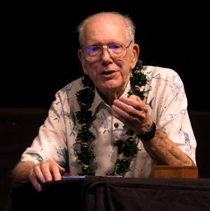 John Randall sitting at table