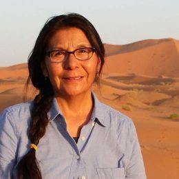 Singer smiling in a desert