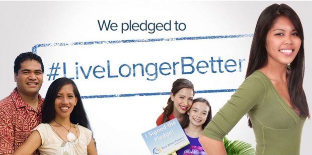 smiling people with a banner that says, We pledged to live longer better