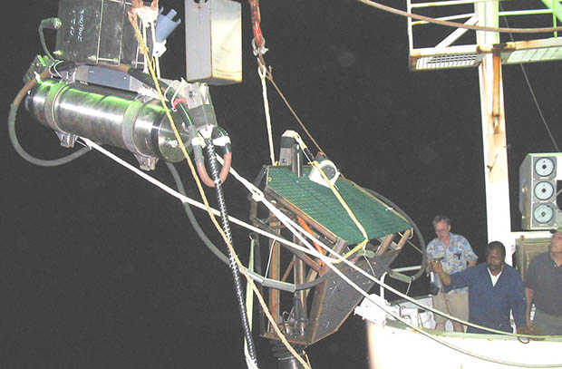Proof Module being lowered from a ship