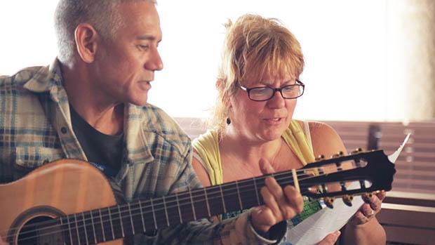 John Signor with a guitar and Jamie McOuat singing along