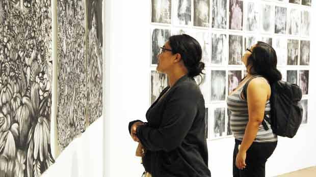 student looking at artwork