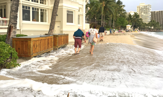 High waves on the beach by the Moana Surfrider