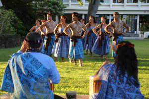 dancers in blue performing on the lawn