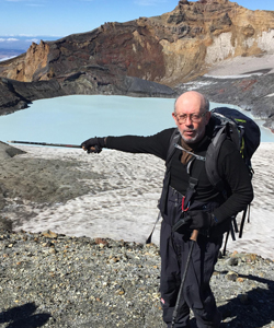 Houghton pointing at a water-filled crater