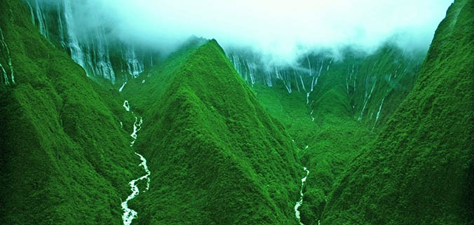 Green mountains with waterfalls