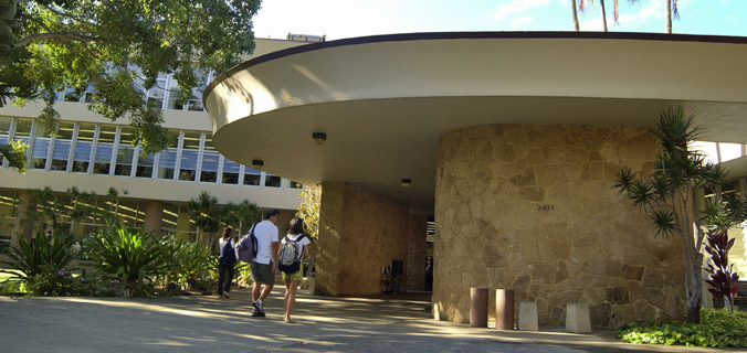 students walking toward the front entrance of the library
