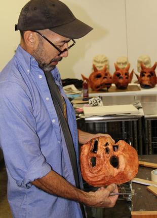 Harada holding ogre mask