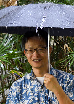 holding an umbrella in the rain