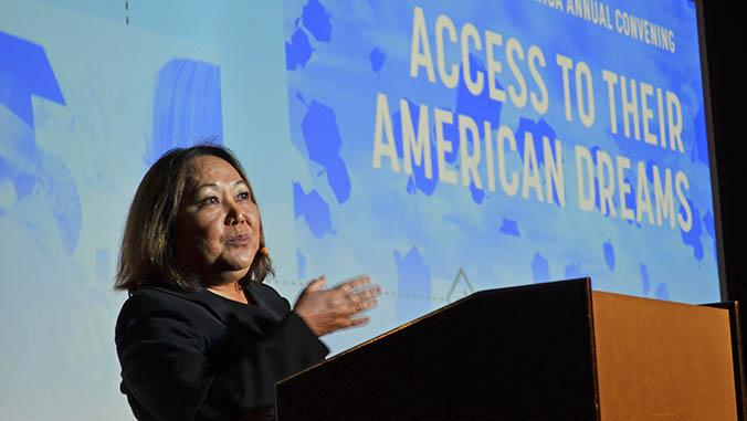 Speaking at a podium