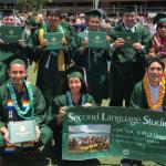 Photo of SLS BA Graduates with their diplomas
