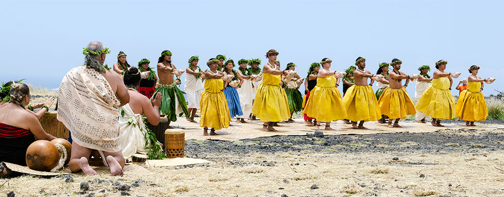 Group of hula dancers and Hawaiian musicians