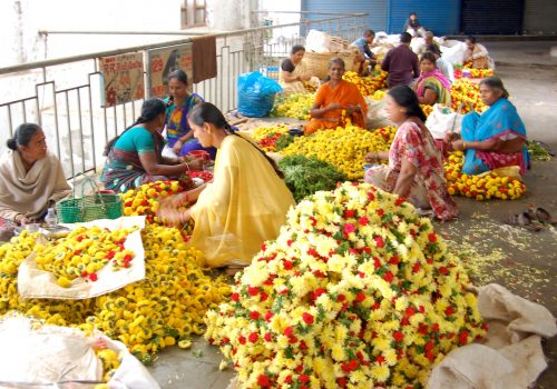 Photo of women selling flowers at a flower market in Bangalore. Seitza's Summer Travel 2016, funded by Watumull Scholarship. Photo by Seitza.