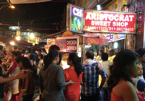Photo of crowds lining up to buy Bengali Sweets on Durga Puja.