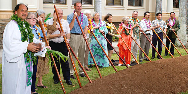 Group Of People With Stick In Dirt