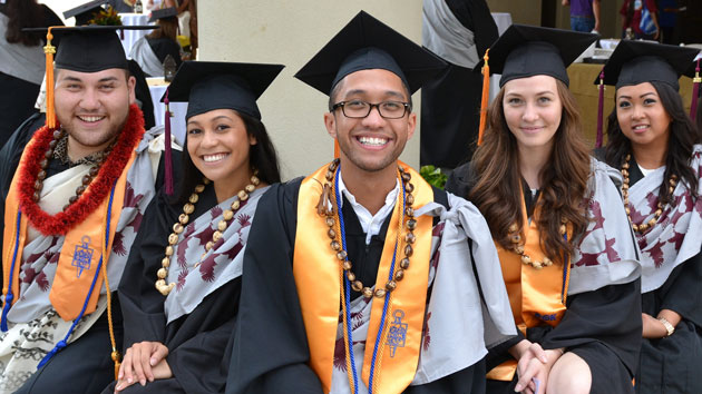 Students wearing commencement regalia