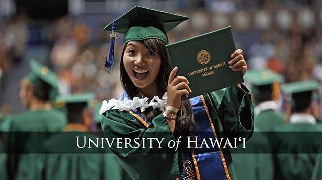 A Happy UH Manoa Graduate Holding Her Diploma