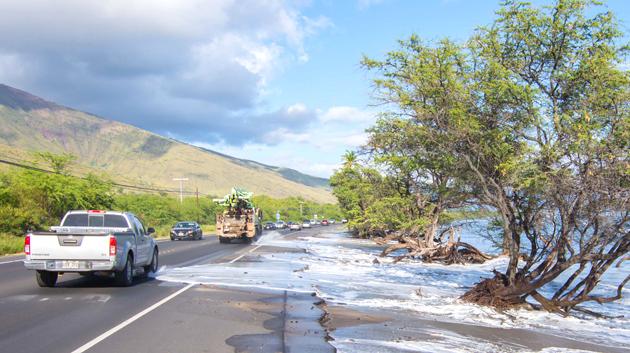 High-tide Ocean Water Flowing Onto Road
