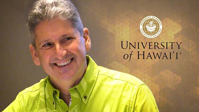 David Lassner and the University of Hawaii seal