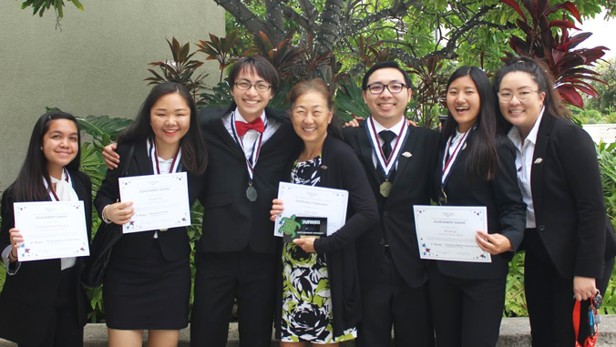 U H Manoa students holding H O S A awards