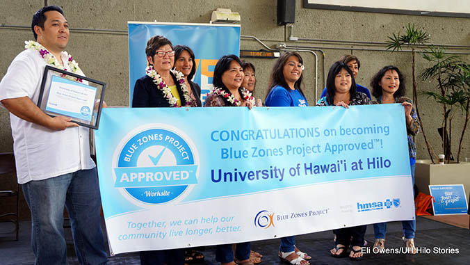 A group of people holding a congratulations banner