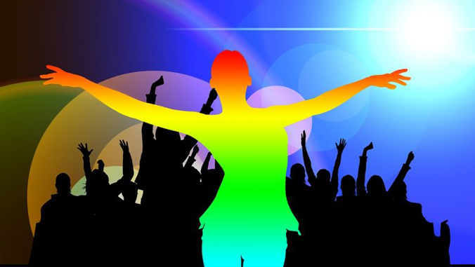 rainbow colored silhouette in front of an audience
