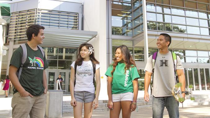 4 students standing in front of U H Manoa Warrior Rec Center
