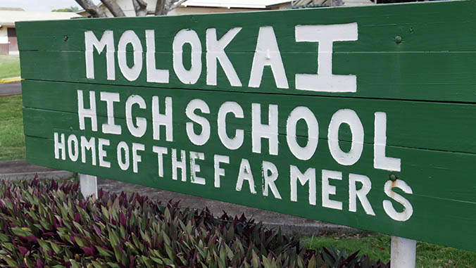 Molokai High School Home of the Farmers sign