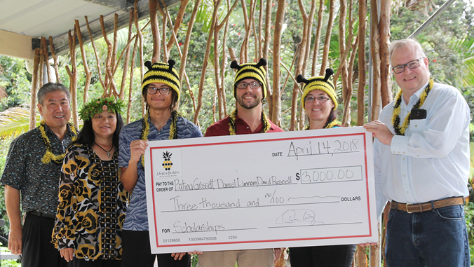Group photo with scholarship check