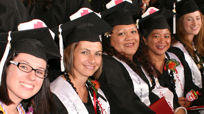 nursing students at graduation wearing cap and gown