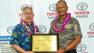 Ching and Cabral holding a plaque