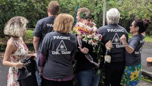 "Dani Atkinson with her family wearing ""Paging Dr. Dani"" shirts"