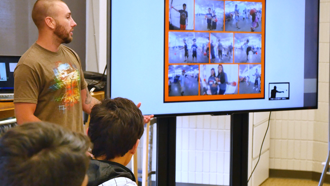 student presenting in front of a class