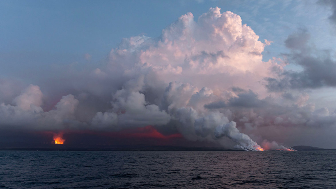 lava pouring into the ocean on Hawaii Island